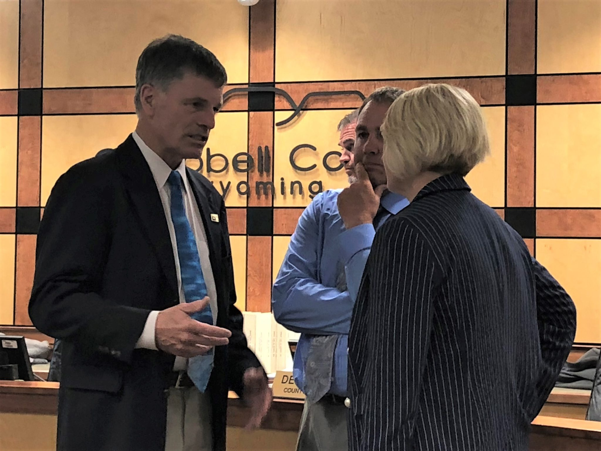 Gov. Mark Gordon talks with Mayor Louise Carter-King and County Commission Chairman Rusty Bell before a public meeting July 2, 2019.