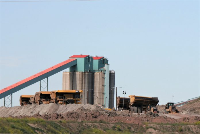 Haul trucks sit idle at Eagle Butte Mine July 1, 2019, after employees were escorted from the property and the gates locked.