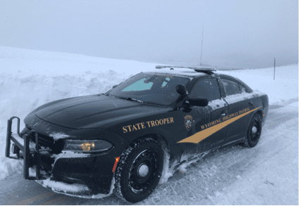 State trooper vehicle in snow, courtesy of the Wyoming Highway Patrol