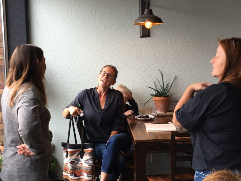Councilwoman Laura Chapman, center, addresses Kim Fry and Rebecca Paul at the Chickens and Coffee with Councilwoman gathering Monday.