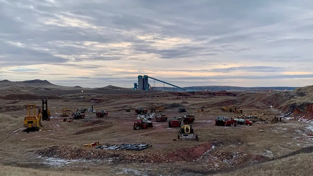 """A """"bone yard"""" outside the Eagle Butte coal mine north of Gillette, filled with old mining equipment. Eagle Butte was one of several coal mines to temporarily close in 2019 due to Blackjewel's bankruptcy (Wyofile/Dustin Bleizeffer, Used with Permission)."""